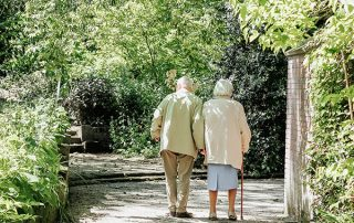 Two older adults sharing a walk